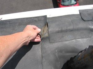 EPDM rubber seams are coming apart.