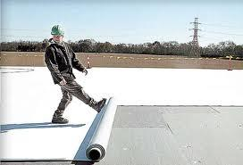 TPO roof, This is made from PVC plastic. This type of roof is very smooth and clean. Does not withstand foot traffic as well as Modified rubber roofs do.