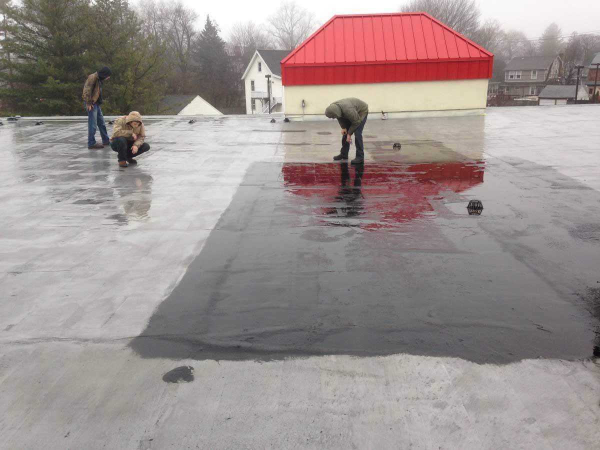 Commercial roofs in Stratford CT leaking - hard to find the leak