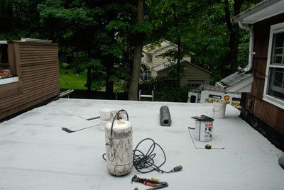 After removing the EPDM rubber we replaced the roof with Modified Bitumen Rubber membrane.