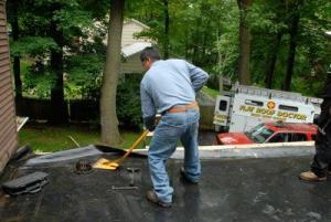 This EPDM roof was leaking and caused the insulation underneath to curl up.