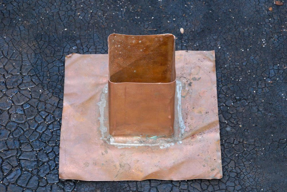 Copper flashing for a post on a flat roof