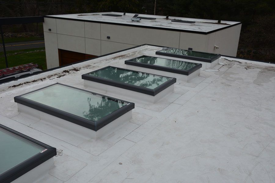 Flat Roof Repairs and TPO Flashing on skylights