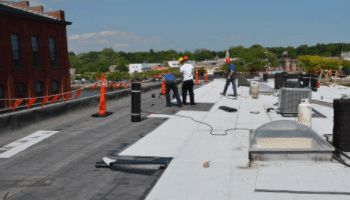Which roofing system offers  the Best Roofing Materials for a Flat Roof?