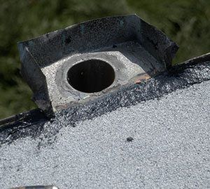 Some scuppers are tied into a down pipe like this one in the picture.