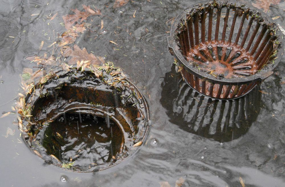 Remove the strainer to wash the debris down the drain. Do not allow twigs and large objects to flow down the drain.