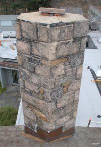 A fieldstone chimney that is leaking