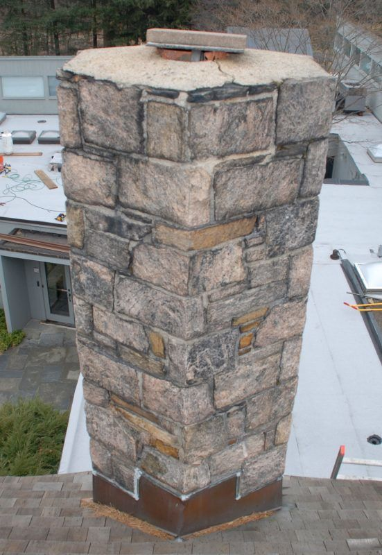 A fieldstone chimney that is leaking