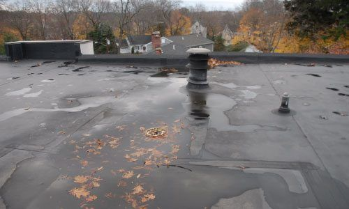This is what a EPDM rubber roof looks like. It is smooth and have less seams. They often need repairs. New Canaan, Westport, Connecticut