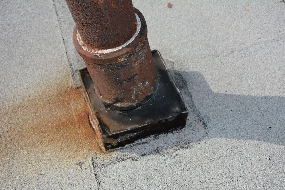 Flat Roof Repair - videos on pitch pockets, drains, flashing, chimney repair
