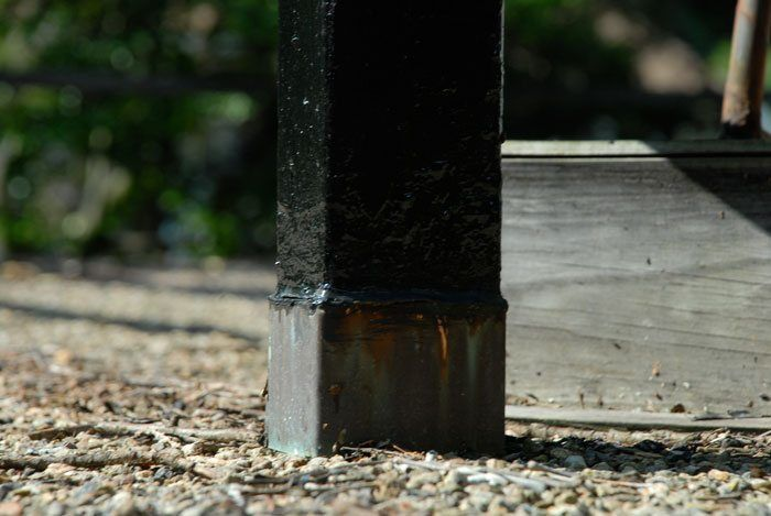 This post on a flat roof have no sleeve. You will notice where the flashing ends is caulking. That is where the water gets in.