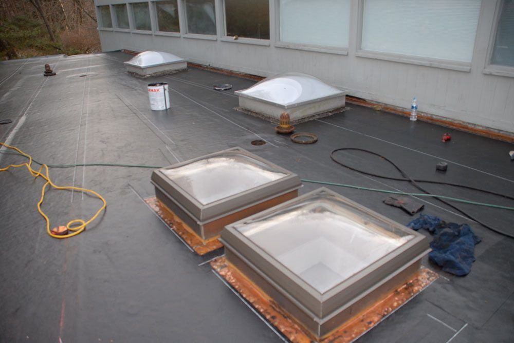 Flashing on the walls and skylights - the base liner is installed and flashing is ready to receive new roof