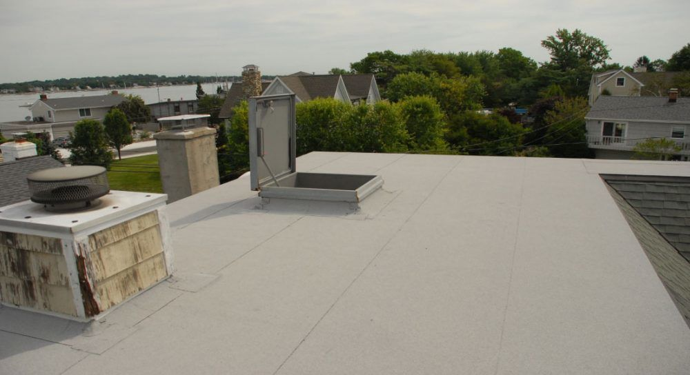 Flat roof repair vent pipes causing leaks for Types of residential roofs