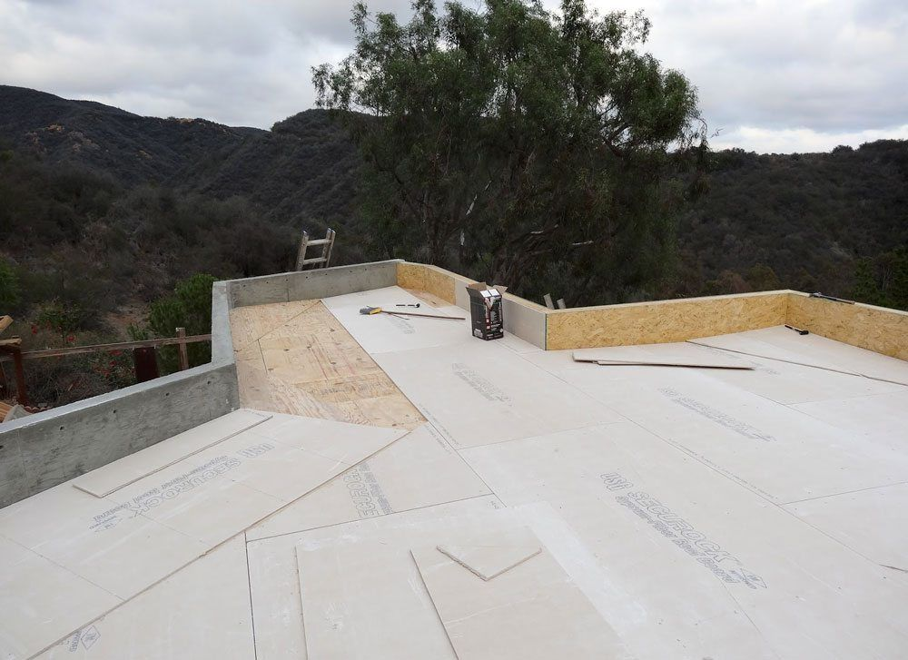Flat roof Los Angeles - Fire protected cement board is installed over plywood