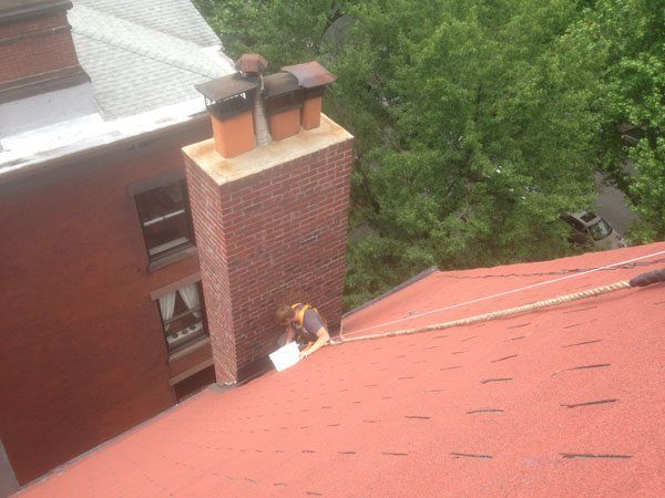 Rappelling to repair flashing on a chimney in Brooklyn, NY.