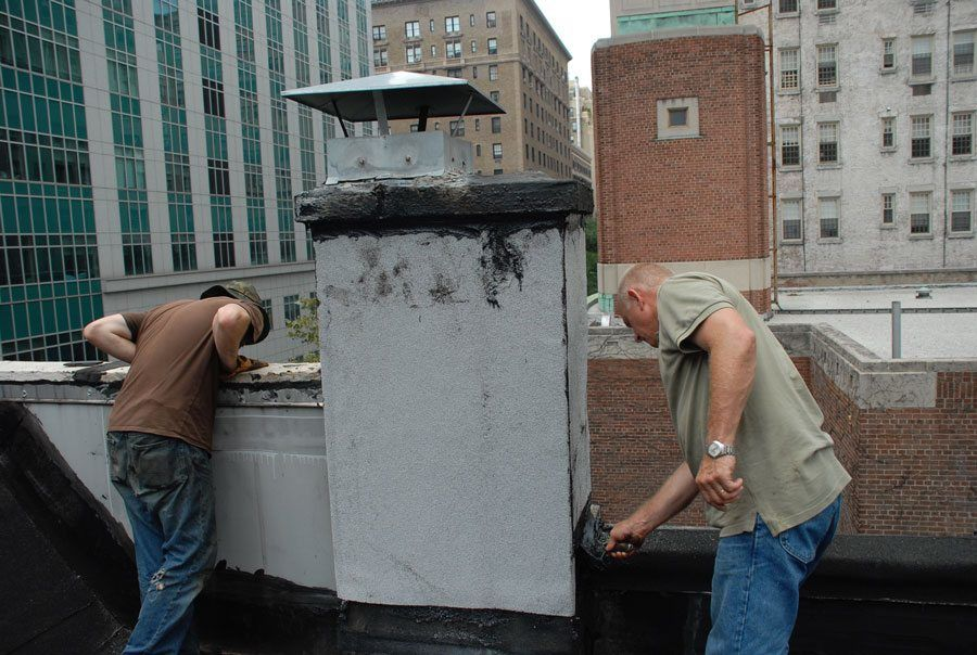 Chimney has been sealed with white ceramic granules embedded in the Modified Bitumen Rubber membrane.