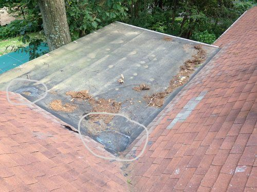 This EPDM Rubber roof shows that a repair was needed due to repeated foot traffic used to access the sloped roof.
