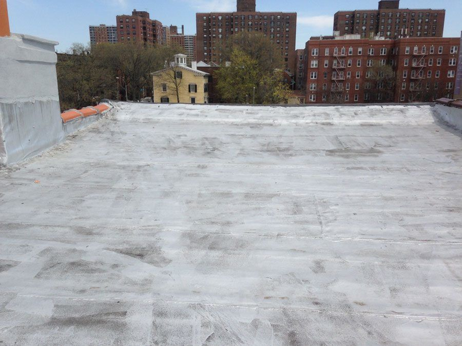 Commercial flat roof installation for Flat roof waterproofing paint
