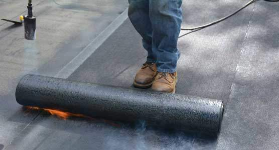 Torching down roofing or heat fusing a Modified Bitumen Rubber Membrane