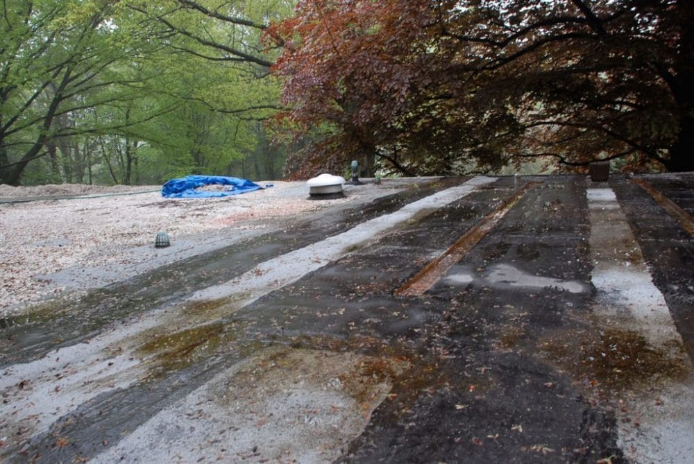Preparing the surface for installing a new rubber roof. Use leave blower