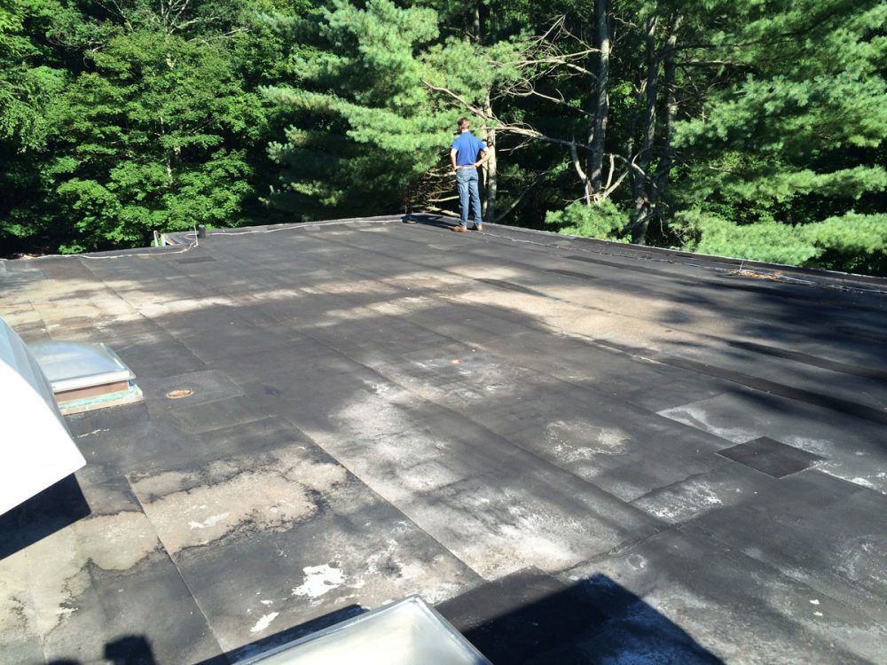 A modified Bitumen Torch Down Rubber Roof ready for a new layer.