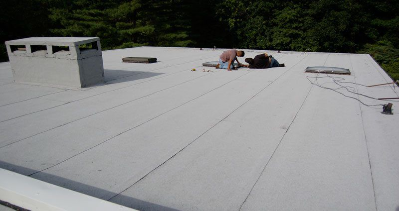 Commercial Flat Roof - The image is an example of a 2 Ply Modified Bitumen Torch Down Rubber Roof System.