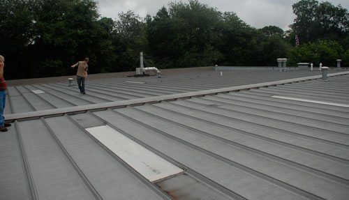 Commercial Flat Roof - Metal roofs systems can be repaired.