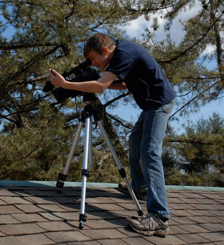 Sven on the camera taking videos of a flat roof