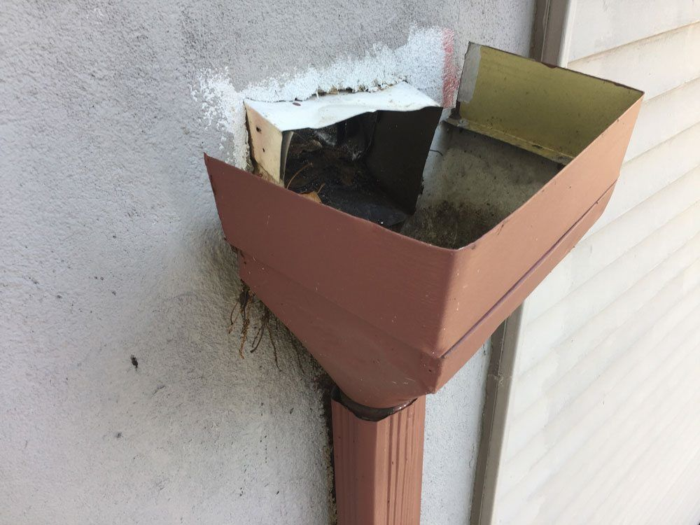Scuppers flat roof repair - Leader Header not attached to wall causing scupper to leak