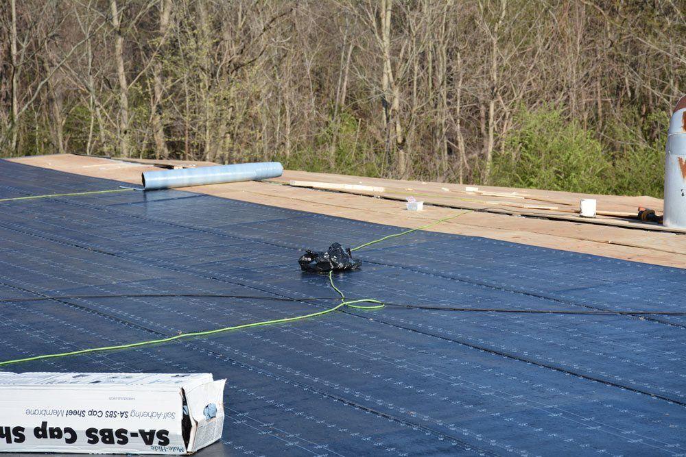 Modified Bitumen self-adhering base sheet is installed