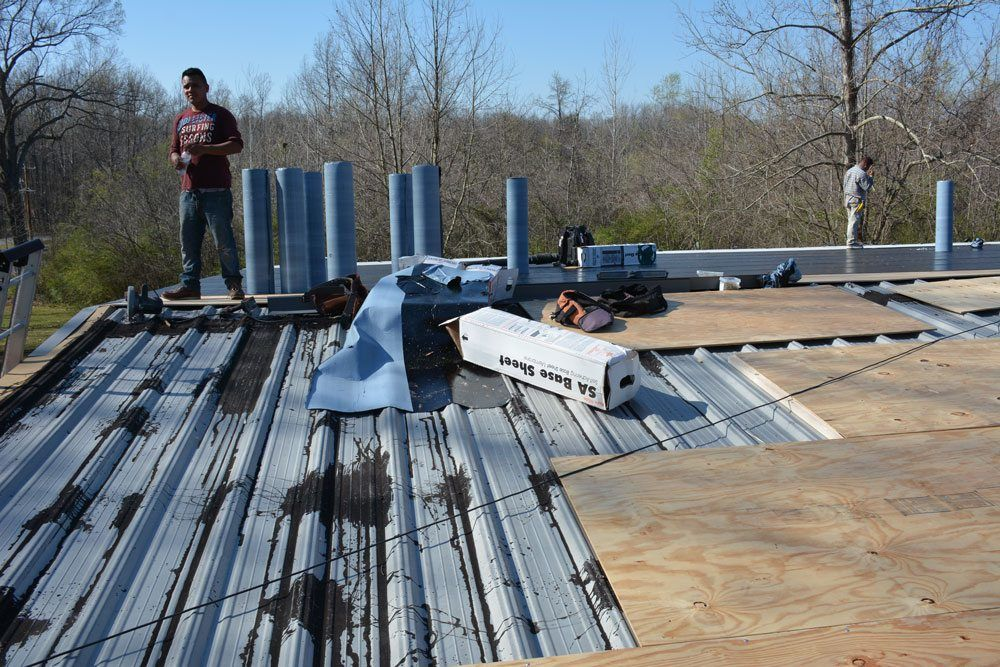 Plywood installation over metal roof