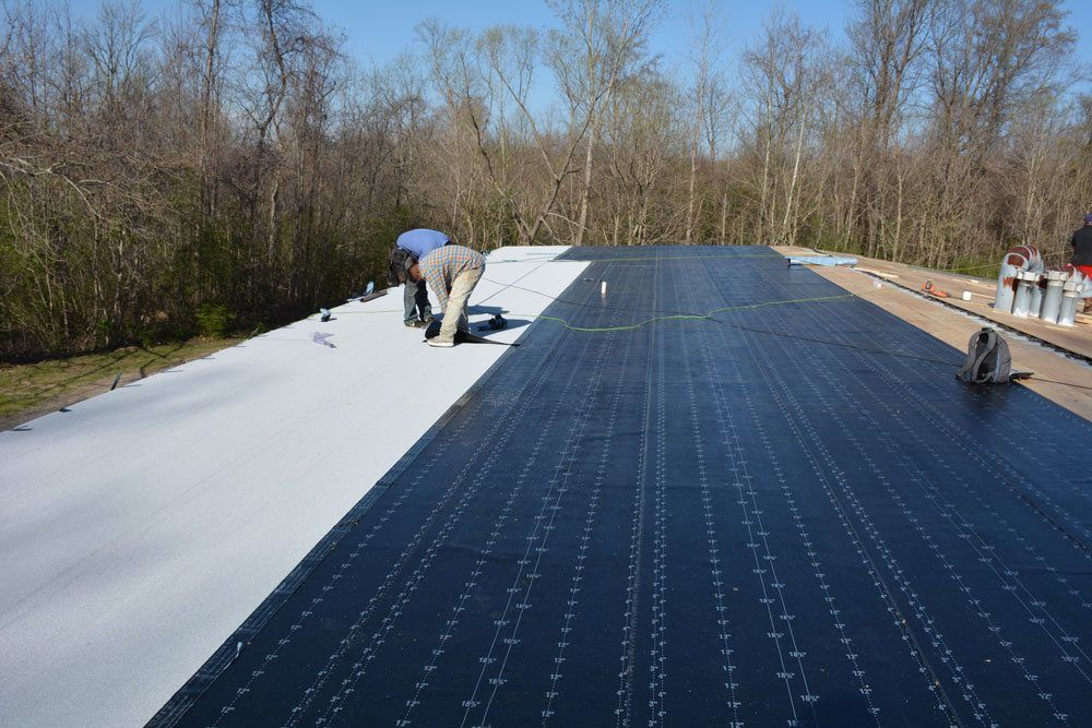 Modified Bitumen Rubber Membrane installed over the base sheet